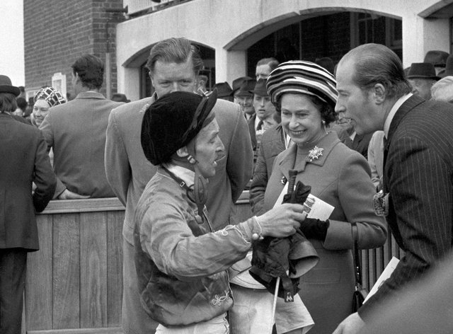 The Queen gets a first-hand account from jockey Joe Mercer after his win on her filly Highclere in the 1000 Guineas