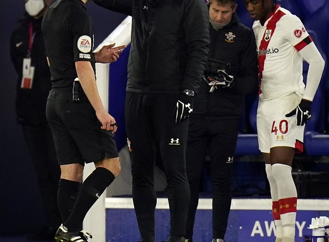 Referee Stuart Attwell speaks to Southampton manager Ralph Hasenhuttl on the touchline