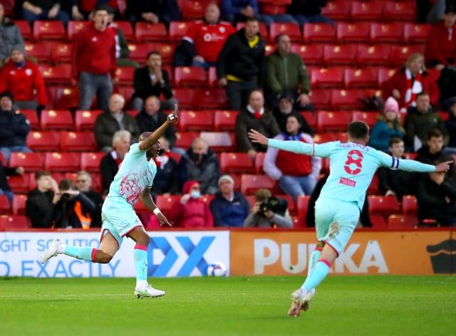 Swansea's Andre Ayew (left) celebrates scoring