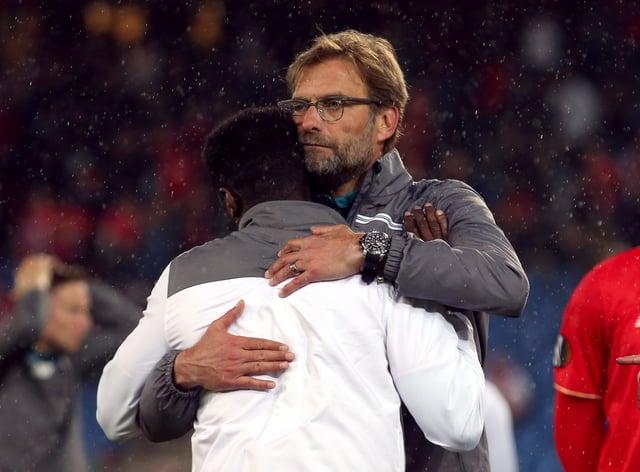 Jurgen Klopp consoles Kolo Toure after Liverpool's loss to Sevilla