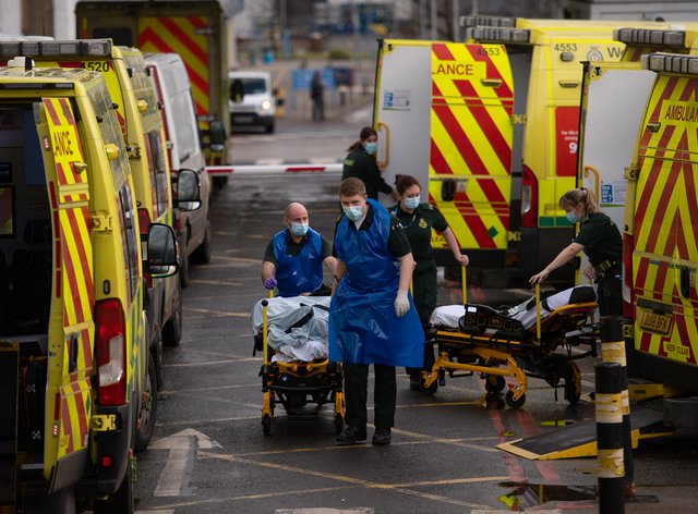An ambulance crew transporting a patient