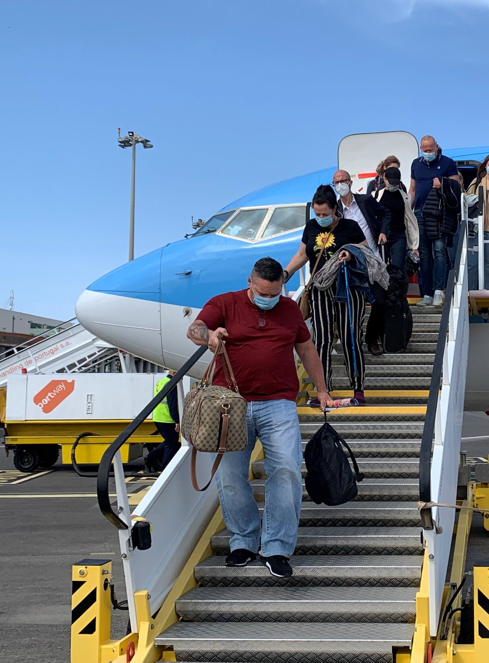 Holidaymakers disembarking from their Gatwick flight in Madeira