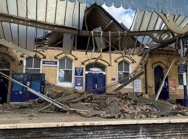 Bricks and other building materials crashed onto a railway station platform when a roof and wall collapsed (Northwich fire station/PA)
