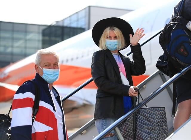 People board plane