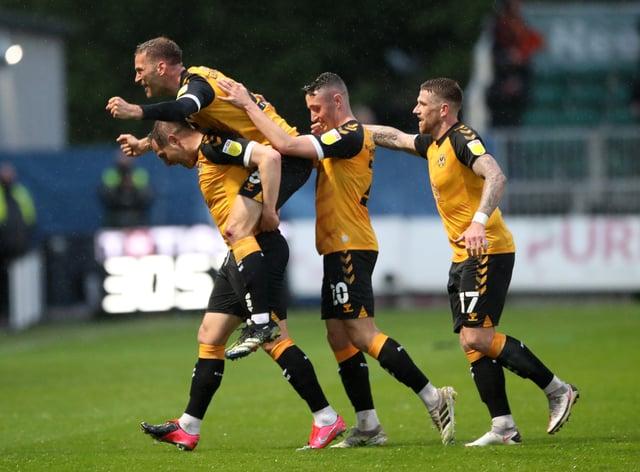 Matt Dolan, left, celebrates his goal