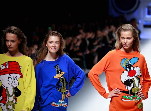 Models at the Moschino fashion show during the 2015 Fall/Winter Milan Fashion Week in Milan, Italy, 26 February 2015.