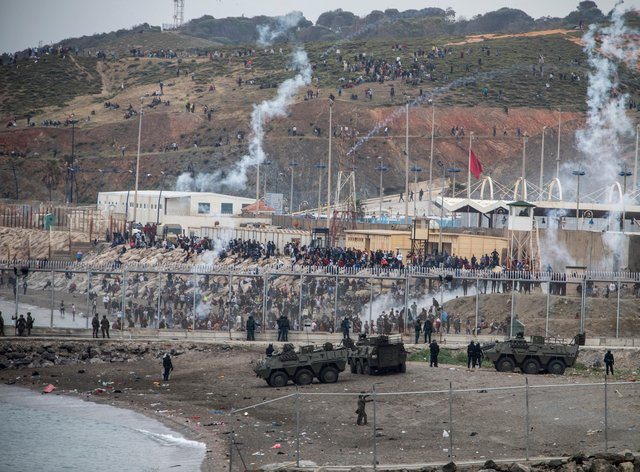 Spanish army and Guardia Civil officers take positions next to the border of Morocco and Spain, at the Spanish enclave of Ceuta