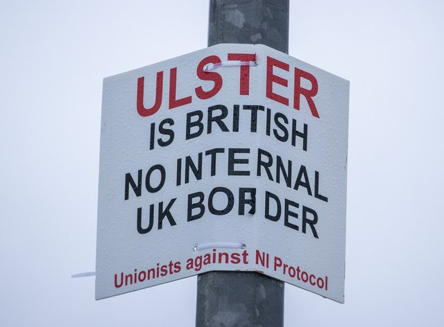 A sign on a lamppost that reads 'Ulster is British – no internal UK Border – Unionists against NI Protocol', opposite the Department of Agriculture, Environment and Rural Affairs (DAERA) Redlands site (Liam McBurney/PA)
