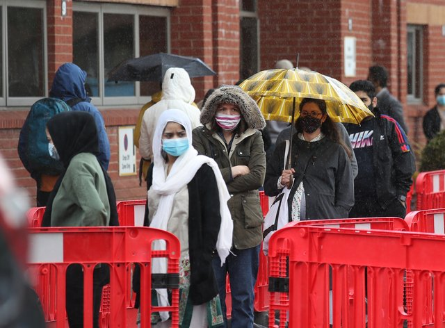 People queue for vaccine