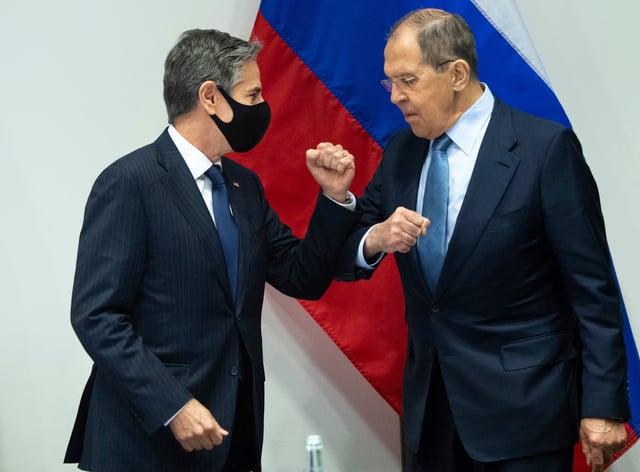 US Secretary of State Antony Blinken, left, greets Russian Foreign Minister Sergey Lavrov in Reykjavik