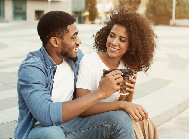 Loving couple relaxing with cup of coffee
