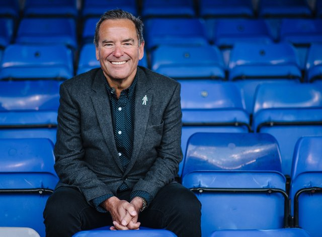Sky Sports presenter Jeff Stelling sits in the stands