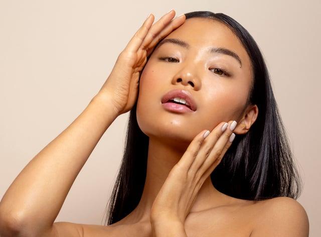 model wearing Ciate Dewy Skin Glass Glow Tint