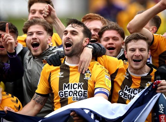 Greg Taylor celebrates