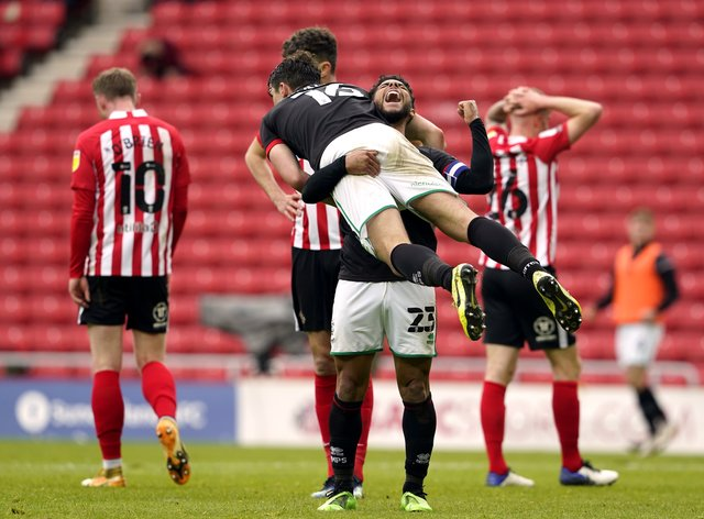 Lincoln celebrate their 3-2 aggregate victory over Sunderland