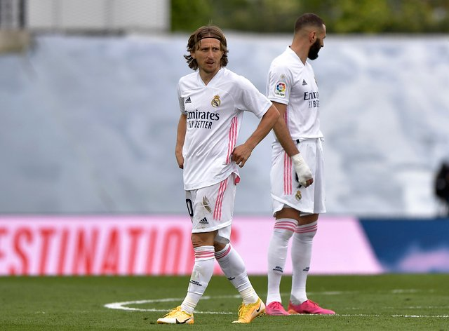 Luka Modric, left, and Karim Benzema scored for Real Madrid but crosstown rivals Atletico won the LaLiga title