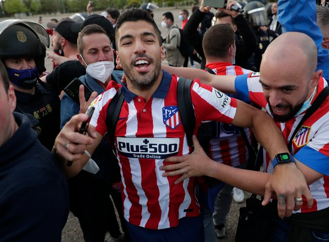 Atletico Madrid's Luis Suarez celebrates with supporters after clinching the LaLiga title