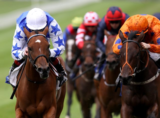 She's Trouble (left) winning at the Curragh