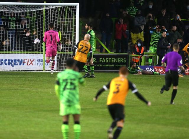 Nicky Maynard, far right, wheels away after scoring Newport's winner