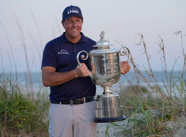 Phil Mickelson holds the Wanamaker Trophy after winning the PGA Championship on the Ocean Course