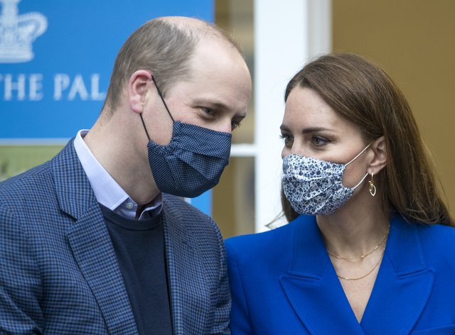 The Duke and Duchess of Cambridge in the cafe kitchen at the Palace of Holyroodhouse, Edinburgh, where they met with representatives of Sikh Sanjog, a Sikh community group (Jane Barlow/PA)