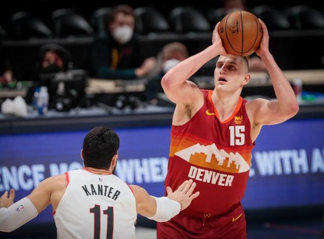 Denver Nuggets center Nikola Jokic (15) shoots over Portland Trail Blazers center Enes Kanter (11)