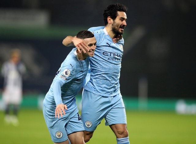 Ilkay Gundogan, right, has been impressed by Phil Foden's form this season