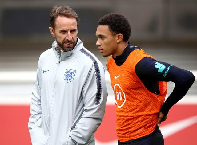 England manager Gareth Southgate, left, speaks with Trent Alexander-Arnold