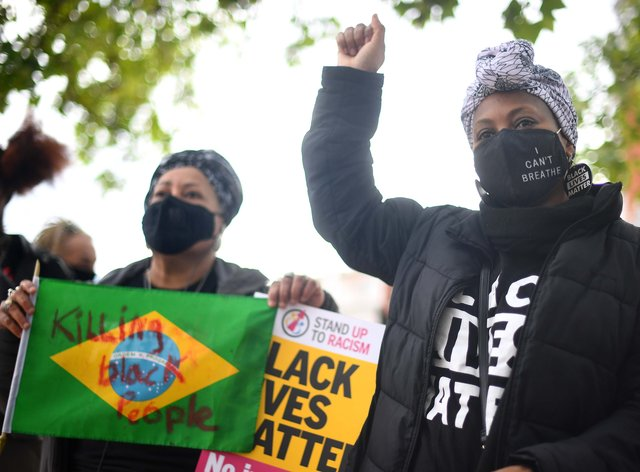 Demonstrators gathered in Brixton, London, a year since George Floyd was killed