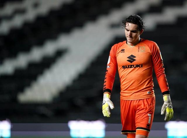 MK Dons goalkeeper Lee Nicholls in action