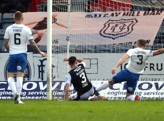Jordan McGhee (centre) netted in Dundee's play-off win over Kilmarnock