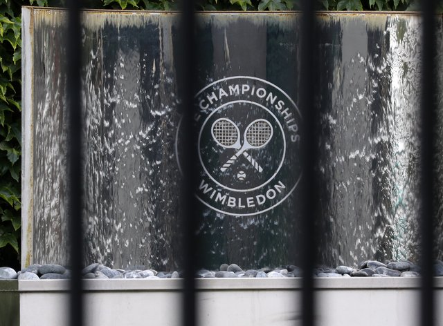 The Wimbledon logo seen through railings