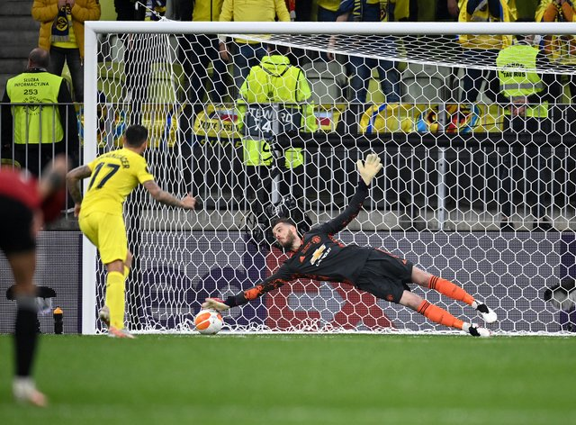 Manchester United goalkeeper David De Gea fails to save Villarreal's Paco Alcacer's penalty