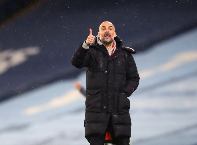 Manchester City manager Pep Guardiola gives a thumbs up gesture