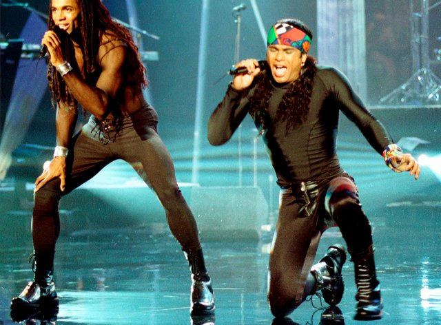 Fabrice Morvan, left, and Rob Pilatus of Milli Vanilli perform during the taping of the Arsenio Hall Show in Los Angeles. John Davis, one of the real singers behind the lip-synching duo, has died of coronavirus (Craig Fuji/AP)