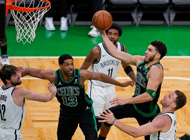 Boston Celtics forward Jayson Tatum drives to the basket past the Brooklyn Nets' Blake Griffin