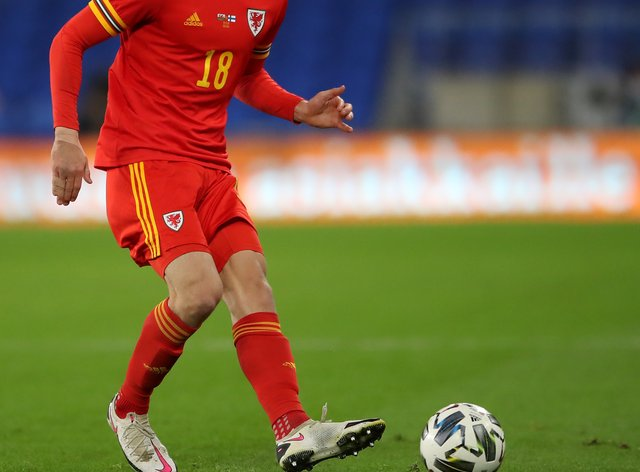 Wales' James Lawrence battles for the ball