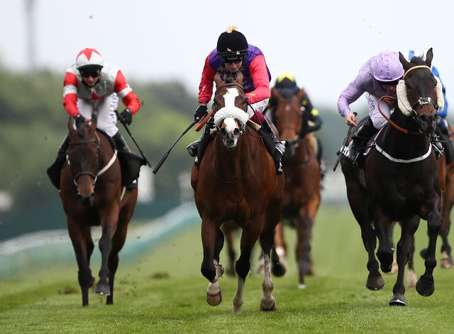 King's Lynn (centre) wins the Achilles Stakes at Haydock