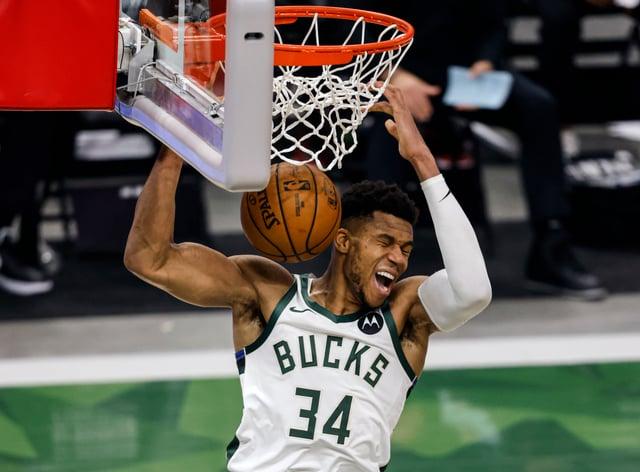 Milwaukee Bucks forward Giannis Antetokounmpo scores a slam dunk