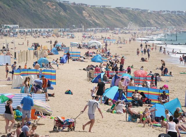 People on Boscombe beach in Bournemouth enjoying the summer sun