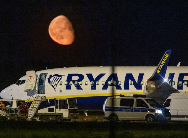 Federal police inspect a Ryanair aircraft after the unscheduled landing of the plane at the Berlin International Airport in Schoenefeld near Berlin, Germany