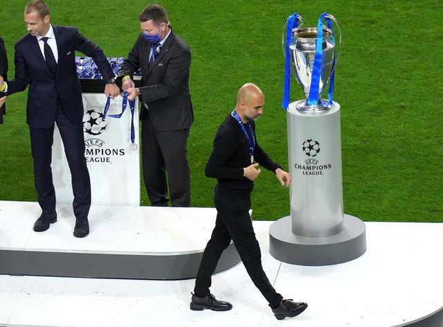 Manchester City boss Pep Guardiola walks past the European Cup after his side were beaten 1-0 by Chelsea in Porto (Adam Davy/PA).