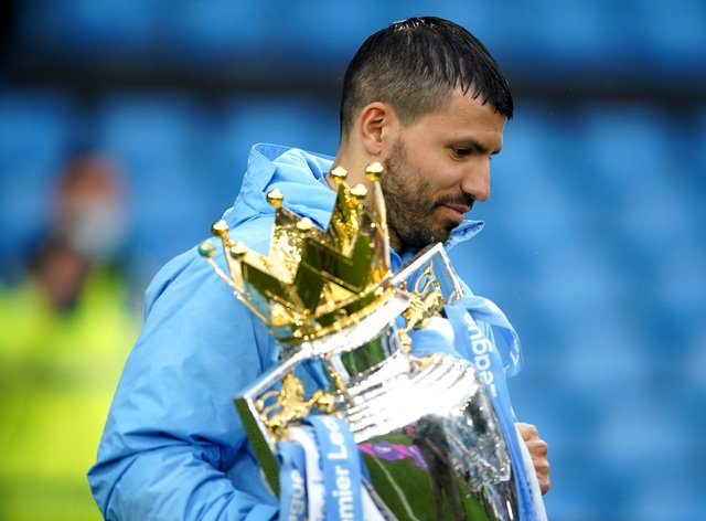 Sergio Aguero, pictured with the Premier League trophy