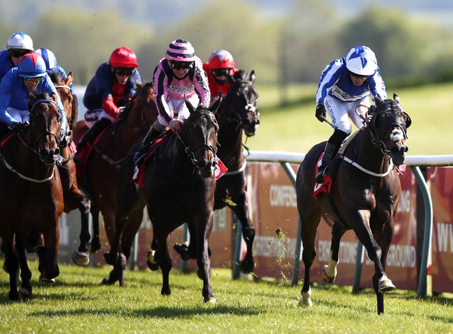 Good Birthday and Silvestre de Sousa (right) take command in the Racing TV Zetland Gold Cup Handicap at Redcar