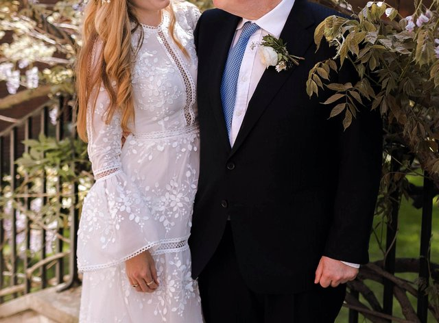 Handout photo of Prime Minister Boris Johnson and Carrie Johnson in the garden of 10 Downing Street after their wedding