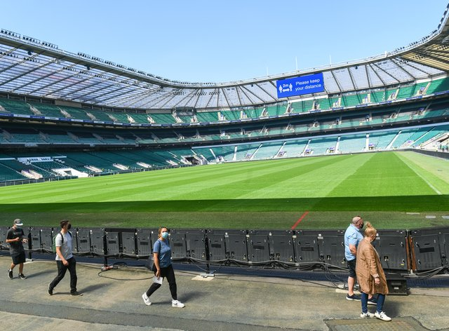 Members of the public arrive to receive a coronavirus vaccination at Twickenham rugby stadium