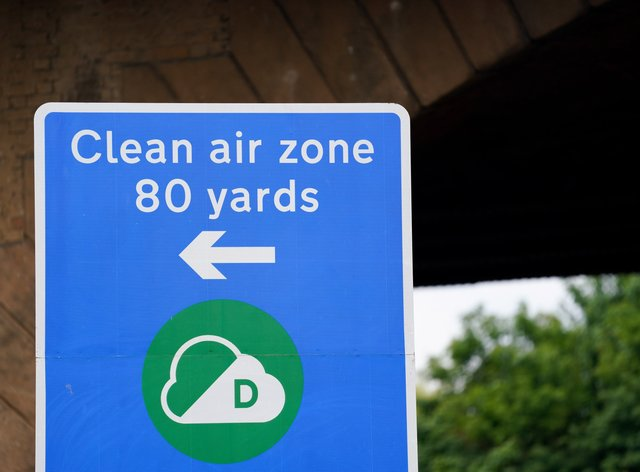 Signs in Birmingham informing road users of the Clean Air Zone initiative