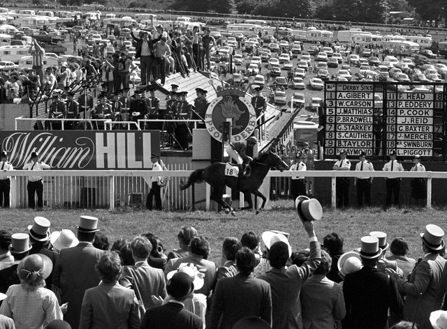 Shergar and Walter Swinburn cross the line well clear to win the Derby by a record margin in 1981