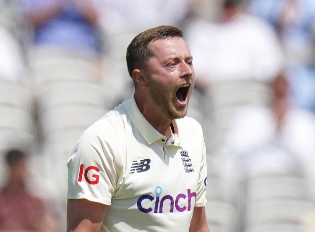 England's Ollie Robinson celebrates taking the wicket of New Zealand's Tom Latham