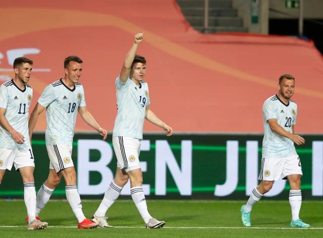 Kevin Nisbet celebrates scoring for Scotland